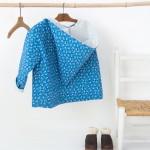 Zoom sur la couture : la veste à capuche pour enfant